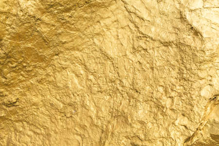 Gold paint stone or rock texture glitter abstract on background. Stockfoto