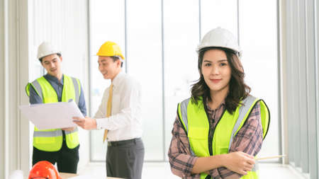 Portrait of confident female construction worker at construction site in office.