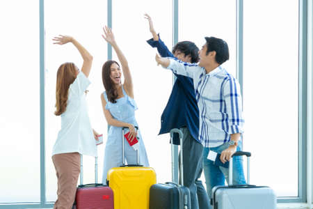 Young people group in Airport Lounge waiting departure and happy smile at airport. 版權商用圖片