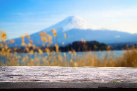 Empty wooden table with terrace beautiful viewblurred beach background.