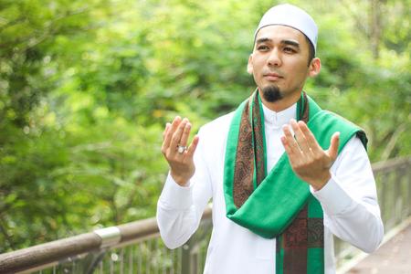 Closeup shot of muslim man recite doa.