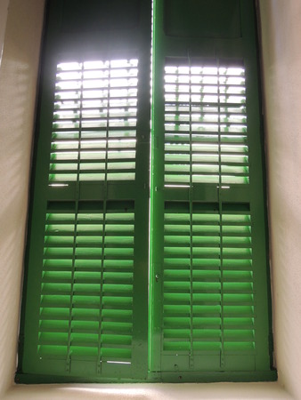 unforeseen: What is behind the green shutters Can be used for illustrating the unknown, mystic, secret, desire, unforeseen, etc.