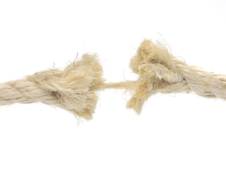 frayed: Risk of breaking - illustrated by frayed rope. Stock Photo