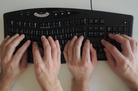 The activity Pair programming in extreme programming and scrum illustrated by two pair of hands on the keyboard.