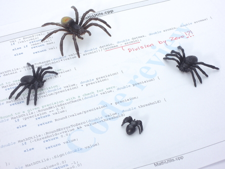 debugging: Bugs in the source code. Division by zero error in a c program. Stock Photo
