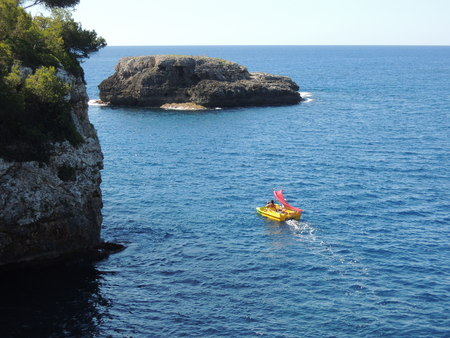 mallorca: Paddleboat on ambitious voyage near Cala dOr, Mallorca, Spain