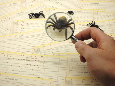 debugging: Inspecting a bug in the source code.