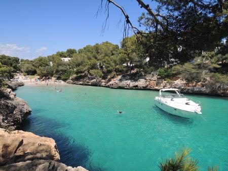 Speedboat anchored at the Cala Serena beach, Cala dOr, Mallorca, Spain.