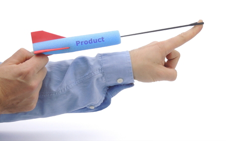 Product launch - illustrated by shooting a foam arrow Imagens
