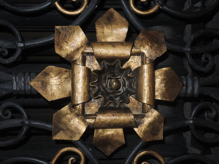 handle bars: Old golden door seal on iron gate. Stock Photo