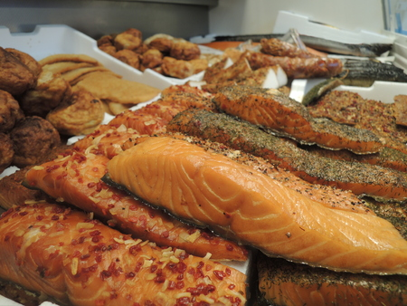 Assorted selection of smoked fish in fish shop.