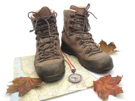 hiking boots: Hiking boots with map, compass and fall leaves