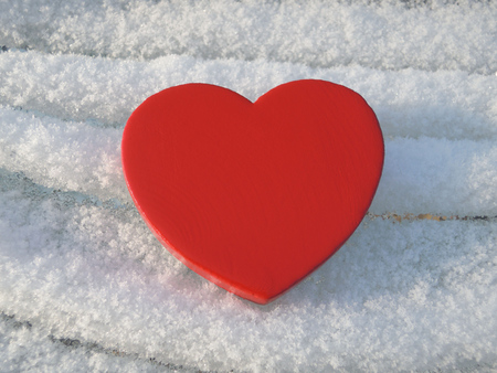 challenged: Love can be a bumpy ride - illustrated by folds of snow Stock Photo