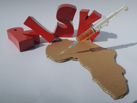 heal new year: 3D letters Risk, Africa, and medicine for illustrating the risk of using untested medicine in West Africa