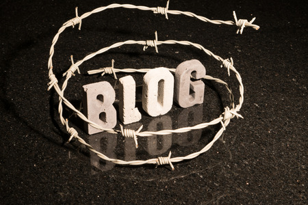 Conceptual or abstract illustration of restricted freedom of speech on blog such as censorship, oppression, or blacklist.