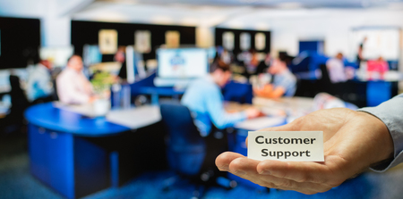 servicing: Customer support center ready for servicing incoming calls from customers Stock Photo