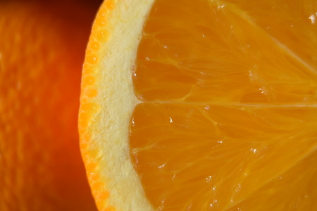 intense flavor: Close-up of sliced orange ready for juicing. Stock Photo