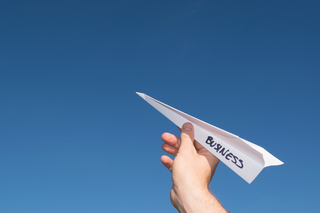 Conceptual illustration of launching a new business. Illustrated by a paper plane. Stock Photo