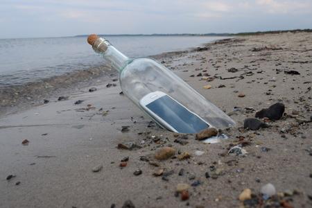 sending: Digital native castaway sending a help message in a bottle.
