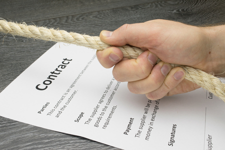 the explanation: Conceptual illustration of tough, hard, or intense contract or business negotiation. Stock Photo