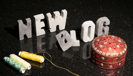 Conceptual or abstract illustration of launching a new fashion, design, sewing, or hand craft blog.