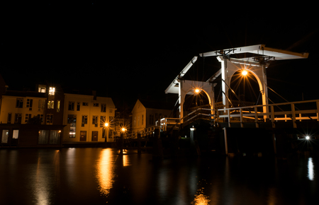 rembrandt: Night shot of the Rembrandt bridge crossing over the Rijn river in Leiden, Netherlands Stock Photo