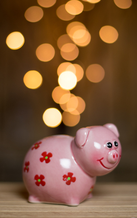 earning: Golden coins raining into the piggy bank. Conceptual illustration of earning money easily.