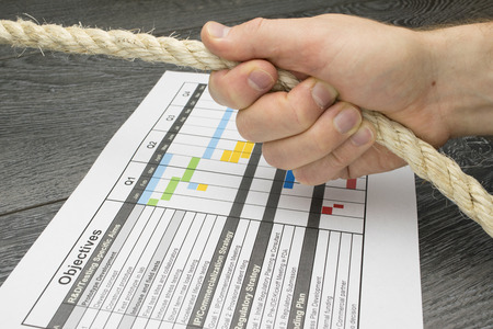 gantt: Conceptual illustration of a Project manager being accountable or responsible for the project plan. Stock Photo