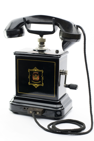 telefono antico: Old black antique telephone with handle for calling the central
