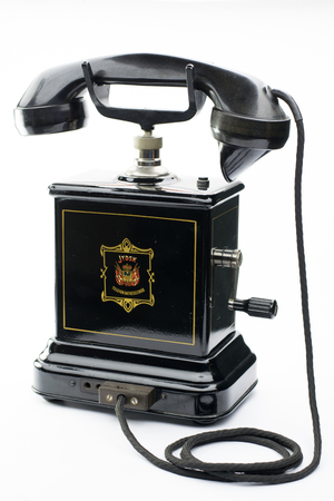 antique telephone: Old black antique telephone with handle for calling the central