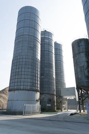 Old steel silos with white cement. Éditoriale