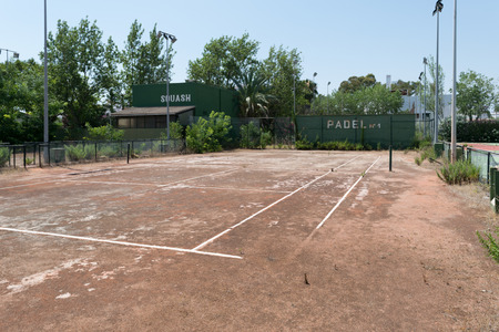 deserted: Abandoned or deserted tennis court.