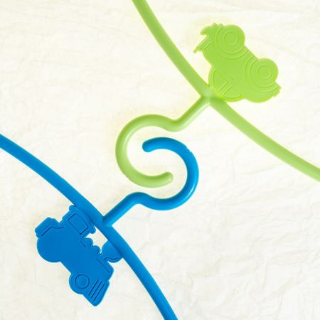 coat rack: colored hanger, coat rack for infants clothing as a colorful  toy