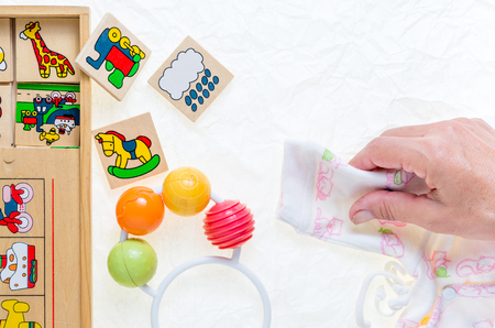 coat rack: colored hanger, coat rack for infants clothing and a colorful rattle toy Stock Photo