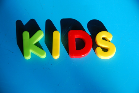 and spelling: Spelling kids with toy letters Stock Photo