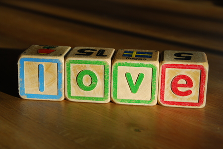 and spelling: Spelling love with toy blocks Stock Photo