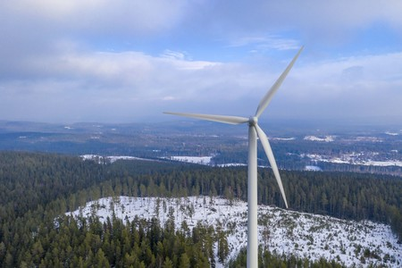 Windmill energy in forest drone photo