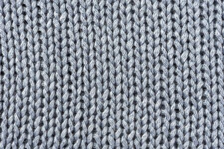 Knitted blue macro background