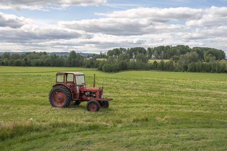 Farming landscape with red tractor