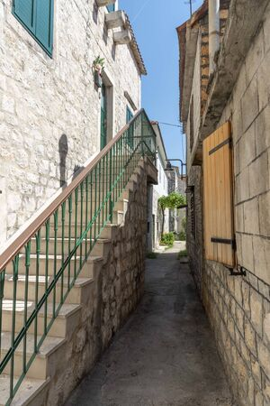 Old alley in Trogir in Croatia
