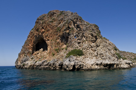 sea monster: Theodore Island is a small islet off the coast of Crete, near Platanias. The Greek name is. The legend says that once a huge sea monster wanted to swallow the island of Crete. Luckily, it was turned into stone. You can see the monsters mouth. This island  Stock Photo
