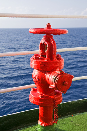 Red fire hydrant on board a ship in the Mediterranean sea.