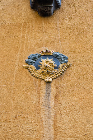 stan: A coat of arms on a wall of an old building in Gamla Stan Old Town Stockholm, Sweden.