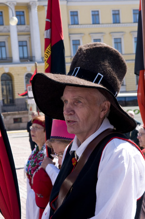 national culture: June 20, 2010. Helsinki, Finland. A man wearing traditional clothes and a hat representing his region during a Festival of National Culture.