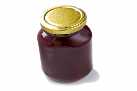 Homemade black currant jam in a glass jar on whiteground. Stok Fotoğraf