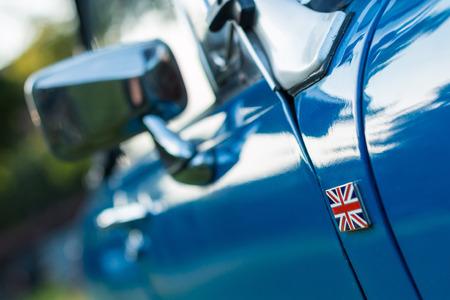 midget: vintage car detail - side union jack badge Stock Photo