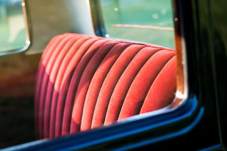 vintage car detail - red rear seat Reklamní fotografie