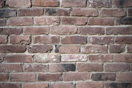 Old colorful resaturated brick wall texture, may be used as background
