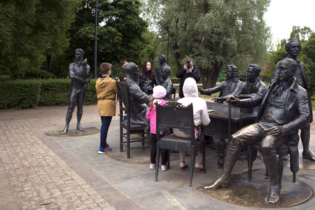 Saint-Petersburg, Russia, June 8, 2018. People make photos near the sculptural ensemble depicting famous architects of Saint-Petersburg Editorial