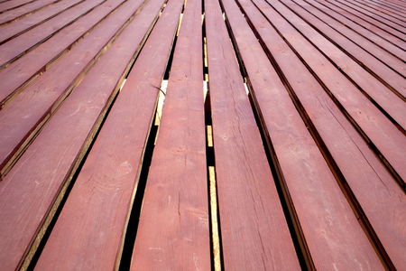 Wooden deck of painted planks with slots, may be used as background or texture Stock Photo